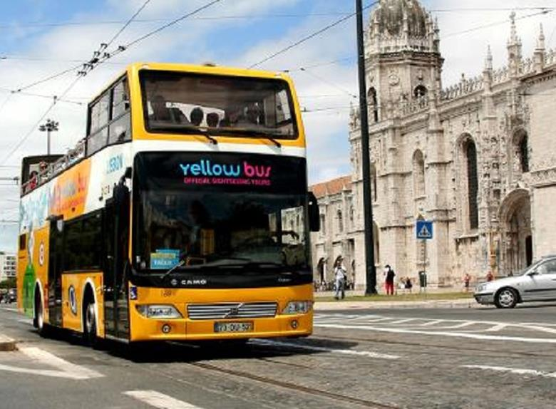 Taking a hop-on hop-off bus ticket in Lisbon is a great way to see the city at your own peace